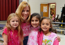 "Children posing with teacher in ""Real Vikings Wear Pink Day"""